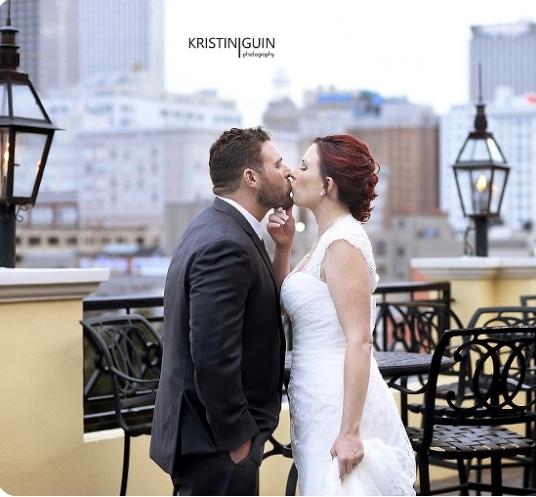 Basin Street Station Rooftop Wedding Kiss Messinas