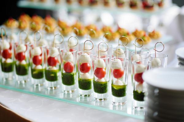 Fresh caprese salad with pesto dressing